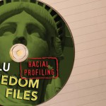 Subtly reinforcing the theme of loss of Freedom of Speech, Lady Liberty's mouth is obscured by the DVD center.